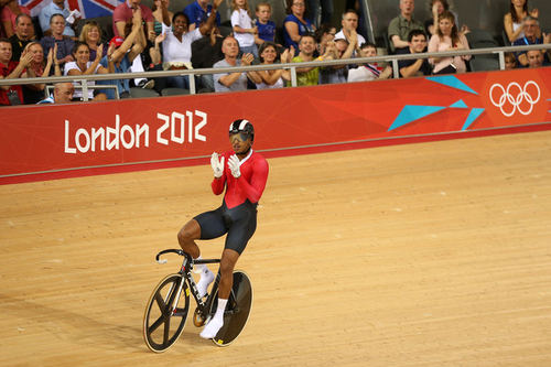 Photo: Njisane Phillip acknowledges the crowd at the London 2012 Olympic Games. (Copyright Track Cycling News)