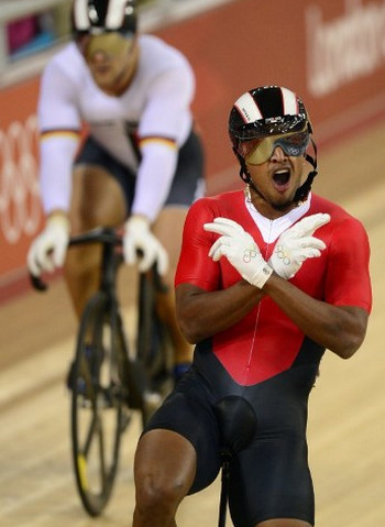 Photo: Njisane Nicholas Phillip celebrates after defeating Germany's Robert Forstemann during the London 2012 Olympic Games men's sprint round at the Velodrome in the Olympic Park in East London on 4 August 2012. (Copyright AFP 2016/Leon Neal)
