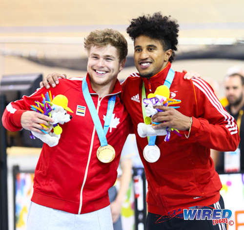 Photo: Canada cyclist Hugo Barrett (left) and Trinidad and Tobago's Njisane Phillip show off their gold and silver medal returns respectively at the Toronto 2015 Pan American Games. (Courtesy Allan V Crane/CA Images/Wired868)