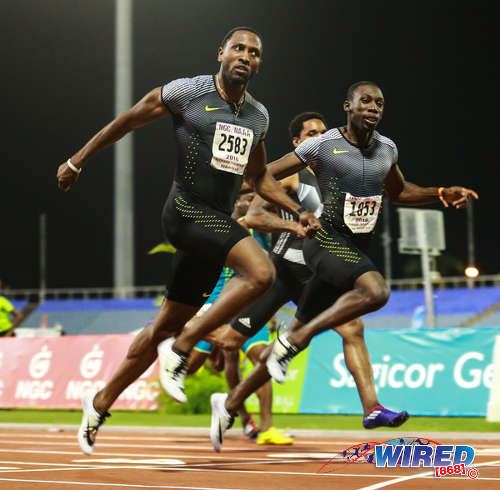 Photo: Trinidad and Tobago sprinters Richard Thompson (left) and Rondell Sorrillo cross the line in the 100 metre final of the NAAA National Open Championships on 25 June 2016 at the Hasely Crawford Stadium in Port of Spain. Thompson won gold at the event followed by Sorrillo, Bledman and Callender respectively. (Courtesy Allan V Crane/CA Images/Wired868)