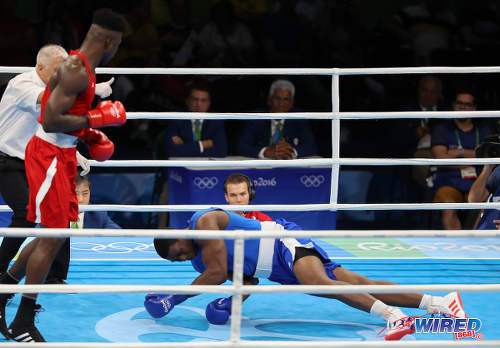 Photo: Trinidad and Tobago boxer Nigel Paul (right) looks for the light switch during his super heavyweight clash with Nigeria's Efe Ajagba in Rio 2016 Olympic competition on 13 August 2016. (Courtesy Sean Morrison/Wired868)