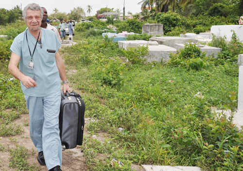 Photo: Pathologist Dr Valery Alexandrov heads to work at a local cemetery. (Copyright Kaiteurnewsonline)