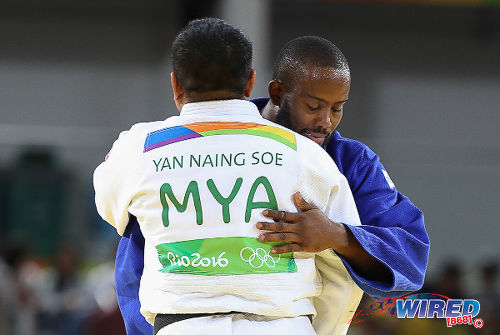 Photo: Trinidad and Tobago's Christopher George (background) congratulates Myanmar's Naing Soe Yan after their judo contest at the Rio 2016 Olympic Games on 11 August. (Courtesy Sean Morrison/Wired868)