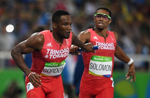Photo: Trinidad and Tobago's Lalonde Gordon (left) receives the baton from Jarrin Solomon during the men's 4x400m relay heat at the Rio 2016 Olympic Games on 19 August 2016. (Copyright Johannes Eisele/AFP 2016/Wired868)