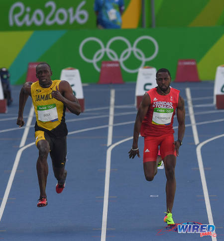 Photo: Trinidad and Tobago's Richard Thompson (right) tries unsuccessfully to hold off Jamaica legend Usain Bolt in the first round of the 100 metre event at the Rio Olympics on 13 August 2016. (Courtesy Sean Morrison/Wired868)