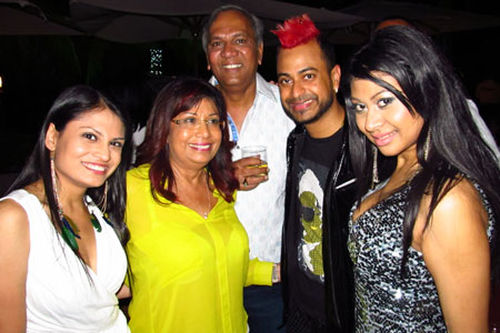 Photo: Construction magnate Junior Sammy (centre) poses with soca chutney stars Nisha B (far right) and Ravi B (second from right).