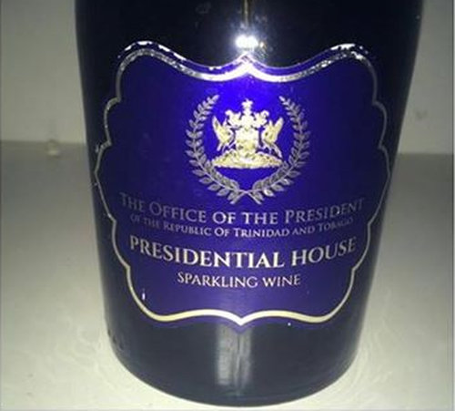 Photo: Wine to the side! A curious label on a bottle of wine has raised questions for President Anthony Carmona. (Courtesy Rhoda Bharath)
