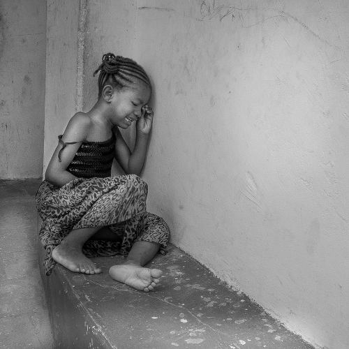 Photo: A molested girl. (Copyright Jamaica Empire)
