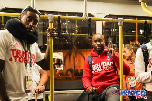 Photo: Trinidad and Tobago Olympians Jehue Gordon (left) and Emmanuel Callender catch the bus during the Rio 2106 Olympic Games. (Courtesy Allan V Crane/Wired868)