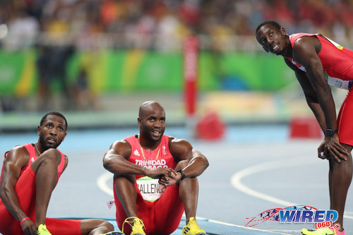 Photo: Trinidad and Tobago sprinters (from left) Richard Thompson, Emmanuel Callender and Rondel Sorrillo watch the electronic scoreboard after their disqualification from the 4x100 metre event during the Rio 2106 Olympic Games. (Courtesy Allan V Crane/Wired868)