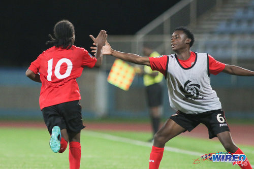 Photo: Trinidad and Tobago National Under-17 Team playmaker Che Benny (left) gets a high five from substitute Brandon Semper during 2017 World Cup qualifying action against Bermuda at the Ato Boldon Stadium on 18 September 2016. (Courtesy Chevaughn Christopher/Wired868)