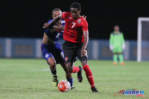 Photo: Trinidad and Tobago National Under-17 Team midfielder Isaiah Hudson (right) tries to hold off Bermuda captain Zuhri Burgess during 2017 World Cup qualifying action at the Ato Boldon Stadium on 18 September 2016. (Courtesy Chevaughn Christopher/Wired868)
