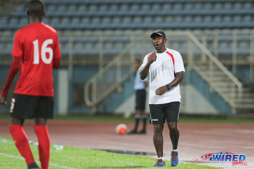 Photo: Trinidad and Tobago National Under-17 Team coach Russell Latapy (right) passes on instructions to midfielder Nickel Orr during Caribbean Football Union (CFU) action against Jamaica on 20 September 2016 at the Ato Boldon Stadium in Couva. (Courtesy Chevaughn Christopher/Wired868)