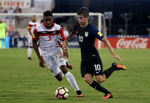 Photo: United States midfielder Christian Pulisic (right) tries to get past Trinidad and Tobago winger Joevin Jones during FIFA 2018 World Cup qualifying action at the EverBank Field on 6 September 2016 in Jacksonville, Florida. (Copyright Sam Greenwood/Getty Images/AFP)