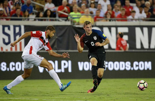 Photo: United States substitute Jordan Morris (right) passes the ball while Trinidad and Tobago defender Radanfah Abu looks on during FIFA 2018 World Cup qualifying action at the EverBank Field on 6 September 2016 in Jacksonville, Florida. (Courtesy CONCACAF)