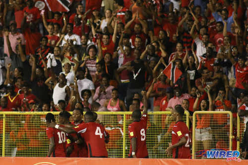 Photo: Trinidad and Tobago midfielder Khaleem Hyland (second from right) gestures to fans after Joevin Jones' second goal against Guatemala during Russia 2018 World Cup qualifying action at the Hasely Crawford Stadium in Port of Spain on Friday 2 September 2016. Both teams played to a 2-2 draw. (Courtesy Chevaughn Christopher/Wired868