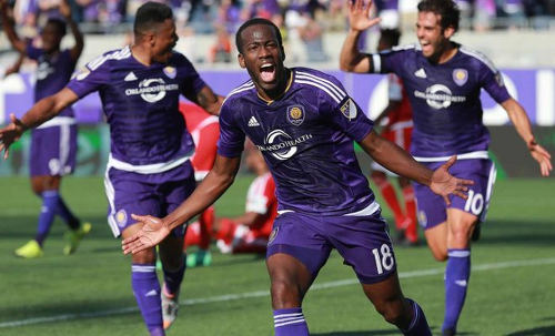 Photo: Orland City midfielder Kevin Molino (centre) celebrates a goal during MLS competition. (Copyright MLS Futbol)
