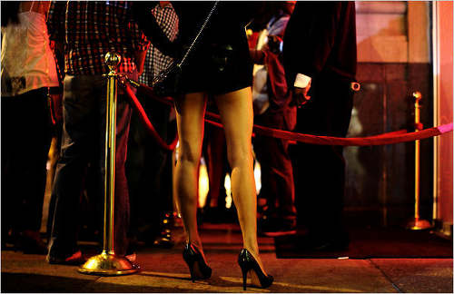 Photo: Patrons line up outside a swanky nightclub. (Copyright NightClubs In NYC)