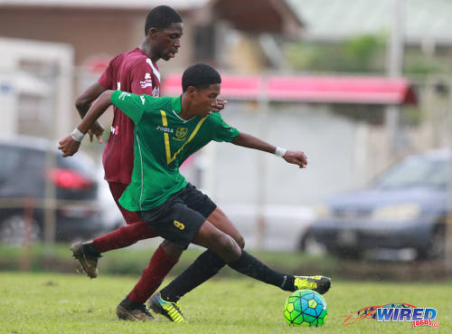 Photo: St Benedict's College midfielder Jaycee Paras (right) tries to turn on an East Mucurapo Secondary opponent during SSFL Premier Division action at Mucurapo Road on 6 October 2016. (Courtesy Nicholas Bhajan/Wired868)