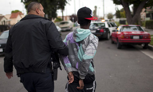 Photo: Police apprehend a young man in Los Angeles. (Copyright Channel4.com)