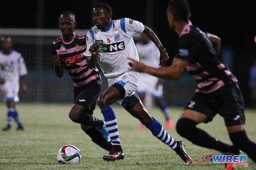 Photo: St Ann's Rangers midfielder Dylon King (centre) charges towards the Ma Pau Stars defence during Pro League action at the Ato Boldon Stadium on 18 October 2016. (Courtesy Chevaughn Christopher/Wired868)