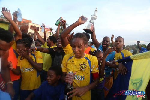 """Photo: Shiva Boys Hindu College stand-in captain Tyrel """"Pappy"""" Emmanuel (front, centre) and his squad celebrate after clinching the 2016 SSFL Premier Division crown with a 3-1 win over Pleasantville Secondary on 22 October 2016. (Courtesy Chevaughn Christopher/Wired868)"""