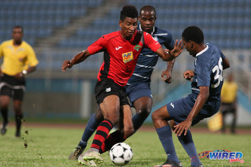 Photo: San Jabloteh striker Willis Plaza (left) takes on Police FC defenders Nequan Caruth (right) and Ryan O'Neil during Pro League at the Ato Boldon Stadium on 1 November 2016. Plaza scored twice as Jabloteh won 3-2. (Courtesy Chevaughn Christopher/Wired868)