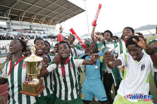 Photo: The San Juan North Secondary football team dances away with the East Zone Intercol trophy after edging St Augustine Secondary 2-1 in the final at the Larry Gomes Stadium, Malabar on 21 November 2016. (Courtesy Annalicia Caruth/Wired868)