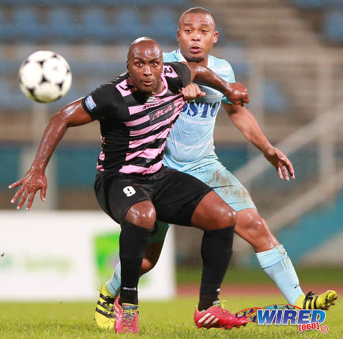 Photo: Ma Pau Stars striker Jason Scotland (left) holds off Police FC midfielder Kenaz Williams in the First Citizens Cup semifinal on 27 November 2016. (Courtesy Allan V Crane/Wired868)