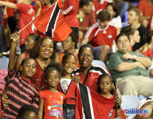 Photo: Trinidad and Tobago supporters pose for a photograph during a break in Russia 2018 World Cup qualifying action against Costa Rica at the Hasely Crawford Stadium on 11 November 2016. (Courtesy Sean Morrison/Wired868)