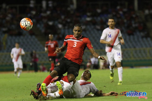 Photo: Trinidad and Tobago winger Joevin Jones (centre) is tackled by two Costa Rican players during Russia 2018 World Cup qualifying action at the Hasely Crawford Stadium on 11 November 2016. (Courtesy Sean Morrison/Wired868)