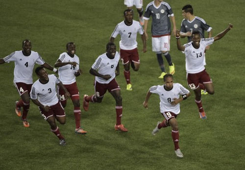 Photo: Trinidad and Tobago's Nathaniel Garcia (second from right) celebrates with teammates after scoring against Paraguay during the 2015 Pan American Games in Hamilton, Canada on 17 July 2015. (Copyright AFP 2016/Omar Torres)