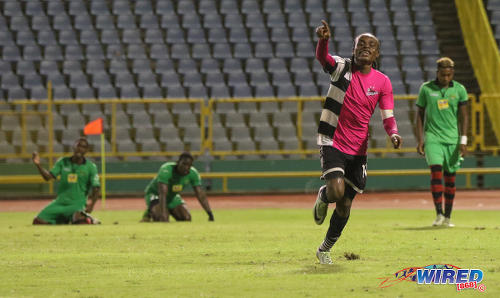 Photo: Central FC midfielder and captain Darren Mitchell (foreground) celebrates his game winning strike against San Juan Jabloteh in Pro League action at the Hasely Crawford Stadium on 2 December 2016. (Courtesy Sean Morrison/Wired868)