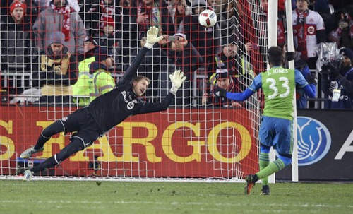 Photo: Joevin Jones (right) buries his penalty kick past Toronto FC goalkeeper Clint Irwin during the MLS Cup final on 10 December 2016 at the BMO Field in Toronto, Ontario, Canada. Seattle defeated Toronto in extra time penalty kicks. (Copyright AFP 2016/Claus Andersen)