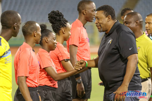 Photo: TTFA president David John-Williams (right) smiles with fourth official Cecile Hinds before the First Citizens Bank Cup final between Defence Force and Ma Pau Stars at the Hasely Crawford Stadium on 2 December 2016. (Courtesy Sean Morrison/Wired868)