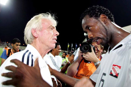 Photo: Former Trinidad and Tobago defender Dennis Lawrence (right) and coach Leo Beenhakker have a word in Manama on 17 November 2005. Lawrence scored the only goal as T&T edged Bahrain 1-0 that night to qualify for the 2006 World Cup. (Copyright Daily Post)