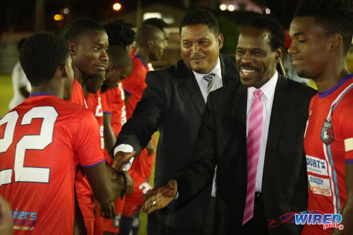 Photo: Sport Minister Darryl Smith (centre) and Minister of Public Utilities Fitzgerald Hinds (second from right) meet players from Morvant Caledonia United before kick off against W Connection at the Hasely Crawford Stadium training ground on 20 January 2017. (Courtesy Sean Morrison/Wired868)