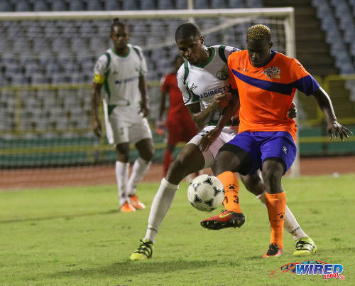 Photo: Club Sando forward Akeem Roach (right) is watched closely by W Connection defender Jelani Peters during Pro League action on 10 January 2017 at the Hasely Crawford Stadium in Port of Spain. (Courtesy Sean Morrison/Wired868)