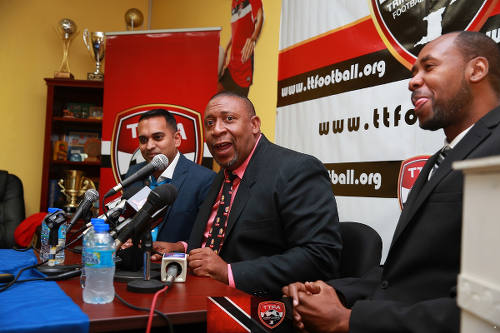 Photo: TTFA president David John-Williams (centre), media officer Shaun Fuentes (left) and new Soca Warriors coach Dennis Lawrence at the TTFA headquarters on 30 January 2017. (Copyright Allan V Crane/TTFA)