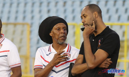 Photo: Trinidad and Tobago National Senior Team head coach Dennis Lawrence (right) chats with National Under-20 Team coach Brian Williams on Thursday 26 January 2017. (Courtesy Sean Morrison/Wired868)
