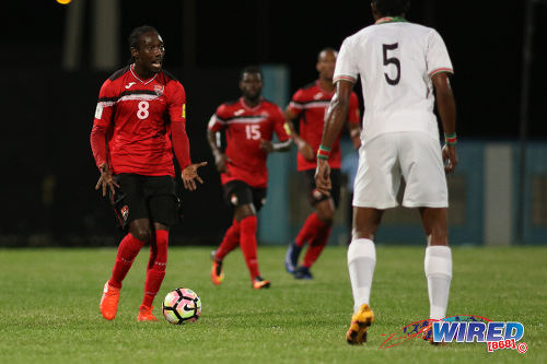 Photo: Trinidad and Tobago winger Nathan Lewis (left) looks for support during 2017 Gold Cup playoff action against Suriname at the Ato Boldon Stadium, Couva on 4 January 2017. (Courtesy Chevaughn Christopher/Wired868)