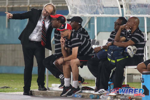 Photo: Trinidad and Tobago National Senior Team head coach Tom Saintfiet (far left) tales to assistant coach Russell Latapy (second from left) during 2017 Gold Cup playoff action against Suriname at the Ato Boldon Stadium, Couva on 4 January 2017. (Courtesy Chevaughn Christopher/Wired868)