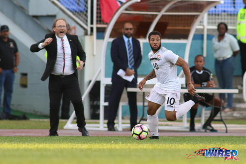 Photo: Trinidad and Tobago National Senior Team head coach Tom Saintfiet (left) cheers on hattrick hero Shahdon Winchester during 2017 Gold Cup playoff action against Haiti at the Ato Boldon Stadium in Couva on 8 January 2017. (Courtesy Chevaughn Christopher/Wired868)