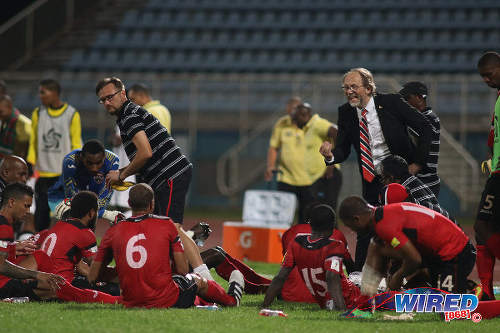 Photo: Trinidad and Tobago National Senior Team head coach Tom Saintfiet (right) talks to his squad during 2017 Gold Cup playoff action against Suriname at the Ato Boldon Stadium, Couva on 4 January 2017. (Courtesy Chevaughn Christopher/Wired868)