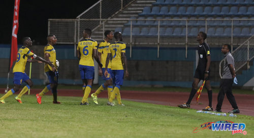Photo: Defence Force players (from right) Jamille Boatswain, Justin Garcia, Rodell Elcock, Chris Durity and Jerwyn Balthazar remonstrate with referee's assistant Caleb Wales (far right) during the Pro Bowl final at the Ato Boldon Stadium on 19 February 2017. Defence Force edged Central FC 5-3 on kicks from the penalty mark after a 2-2 draw. (Courtesy Sean Morrison/Wired868)