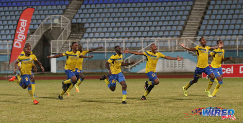 Photo: Defence Force players (from right) Jamali Garcia, Justin Garcia, Curtis Gonzales, Thurlani George, Jerwyn Balthazar, Rodell Elcock and Chris Durity react to teammate Devorn Jorsling's successful penalty kick during the Pro Bowl final at the Ato Boldon Stadium on 19 February 2017. Defence Force edged Central FC 5-3 on kicks from the penalty mark after a 2-2 draw. (Courtesy Sean Morrison/Wired868)