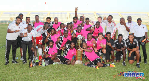 Photo: Central FC players and technical staff celebrate their third successive Pro League title at the Ato Boldon Stadium in Couva, after edging San Juan Jabloteh 1-0 on 5 February 2017. (Courtesy Sean Morrison/Wired868)