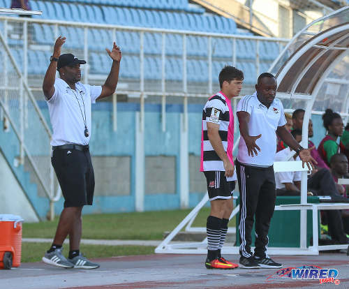 Photo: Central FC head coach Dale Saunders (right) gives instructions to substitute Sean De Silva (centre) while assistant coach Stern John gestures during Pro League action against San Juan Jabloteh at the Ato Boldon Stadium in Couva on 5 February 2017. (Courtesy Sean Morrison/Wired868)