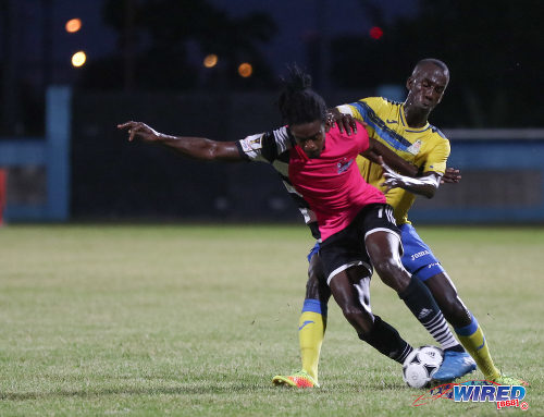 Photo: Central FC attacker Jason Marcano (left) tries to wriggle clear of Defence Force captain Jerwyn Balthazar during the Pro Bowl final on 19 February 2017 at the Ato Boldon Stadium. Defence Force won 5-3 on kicks from the penalty mark after a 2-2 draw. (Courtesy Sean Morrison/Wired868)