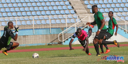 Photo: Central FC attacker Rundell Winchester (centre) sends a diving header past San Juan Jabloteh goalkeeper Javon Sample (left) during Pro League action at the Ato Boldon Stadium in Couva on 5 February 2017. Looking on are Jabloteh players Nathan Lewis (far right) and Josiah Trimmingham. (Courtesy Sean Morrison/Wired868)